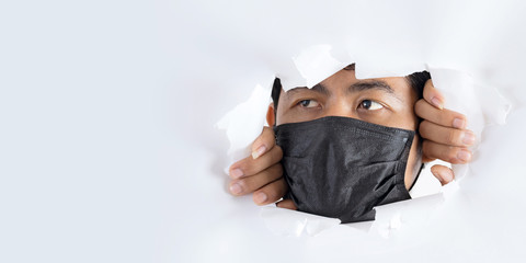 Close-up portrait of man wearing protection face mask against coronavirus