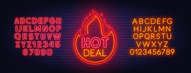 Hot deal neon sign. Neon alphabet on brick wall background.