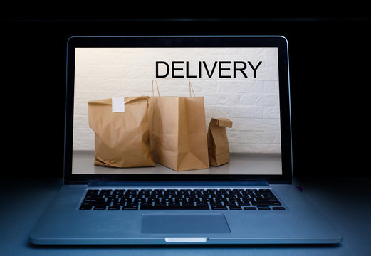 ordering take away food by internet with a laptop, food delivery