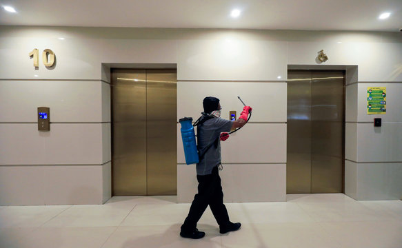 A worker cleans elevators area near offices at Parkland, as the number of people tested positive for coronavirus in the country increased, in Colombo
