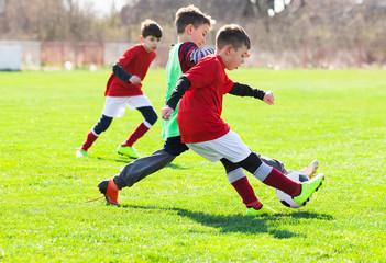 Boys play soccer sports field