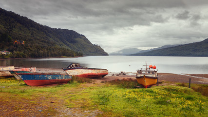 Fishing boats on the beach of Puyuhuapi Fjord, Patagonia, Chile, Pacific Ocean