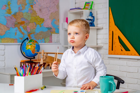 Child tutoring. School kids. After school teaching. Learning and education concept. Home study. Cute child boy in classroom near blackboard desk.