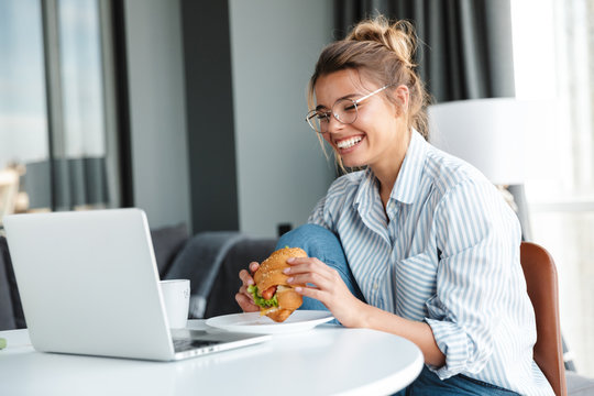 Smiling young businesswoman having lunch