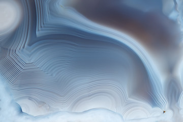 Close- up texture of blue -white agate with a smooth concentric structure