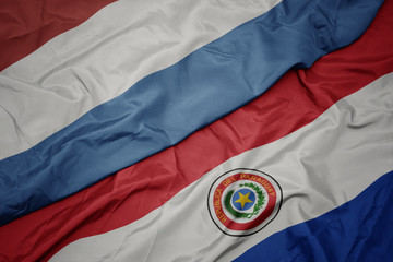 Deurstickers Noord Europa waving colorful flag of paraguay and national flag of luxembourg.