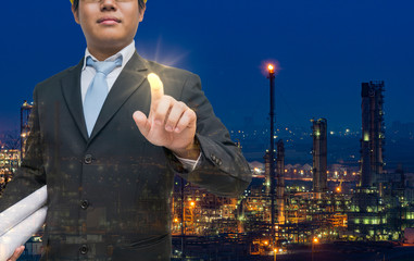 stock market investor choosing to investment petroleum industry with oil refinery plant background. investment, petroleum, petrochemical, oil industry, business, stock market or environment concept