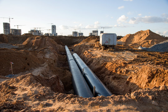 Cast iron sewer pipes for laying an external sewage system at a construction site. Sanitary drainage system for a multi-story building. Civil infrastructure pipe, water lines and storm sewers