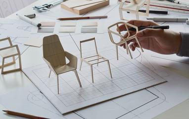Designer sketching drawing design development product plan draft chair armchair Wingback Interior furniture prototype manufacturing production. designer studio concept .