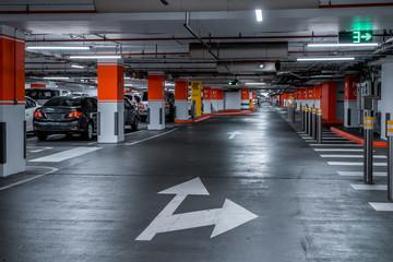 Parking garage - interior shot of multi-story car park, underground parking with cars Fototapete