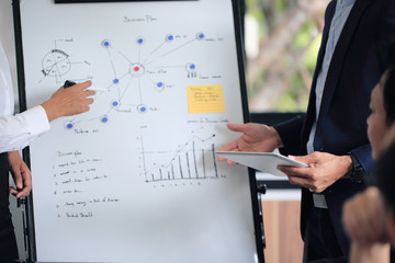 Group businessman meetings to brainstorm, analyze and plan for marketing.