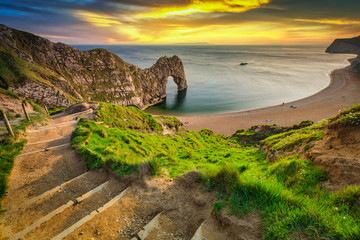 Durdle Door at the beach on the Jurassic Coast of Dorset at sunset, UK