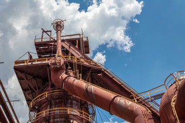 Sloss Furnaces National Historic Landmark, Birmingham Alabama USA, sunlight and clouds on a steel mill manufacturing facility, horizontal aspect