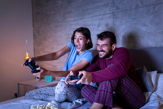 Couple having fun playing video games