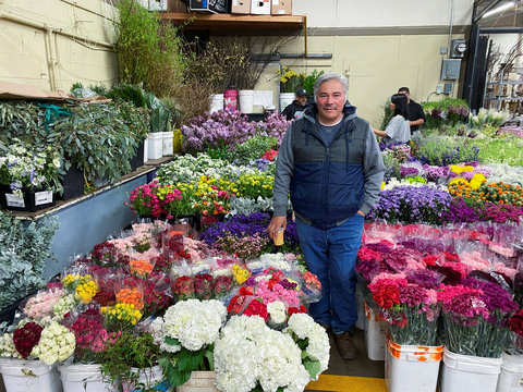 Jose Guadalupe stands among his inventory at San Francisco's wholesale flower market, where business has been hit hard by bans on large events amid coronavirus (COVID-19) concerns, in San Francisco