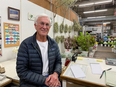 Louie Figoni poses at his flower stand at San Francisco's wholesale flower market, where business has been hit hard by bans on large events amid coronavirus (COVID-19) concerns, in San Francisco