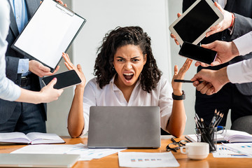 Angry Businesswoman At Laptop Shouting Furiously Sitting In Office