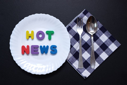 Colorful letters are on plate hot news messages on the hook