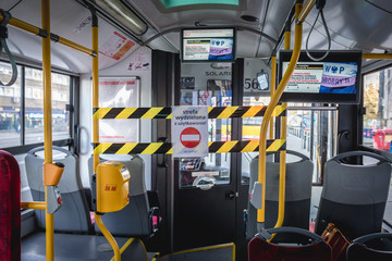 Warsaw, Poland - March 17, 2019: Closed driver area in public bus in Warsaw after Polish government has declared a state of epidemic threat to limit spread of Coronavirus