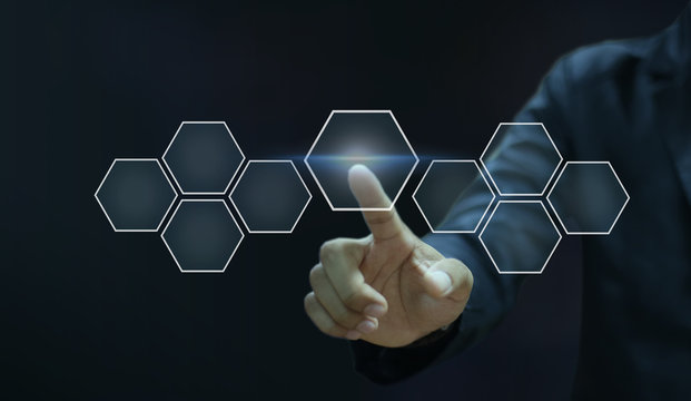 Businessman pointing his finger touch hexagon icon