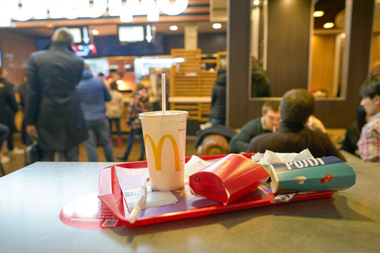 MOSCOW, RUSSIA - CIRCA OCTOBER, 2018: left food tray on a table at McDonald's restaurant in shopping center.
