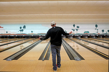 A man bowls in a nearly empty bowling alley inside McCall's Tavern at Spanish Springs Town Square, amid coronavirus (COVID-19) cases in The Villages, Florida