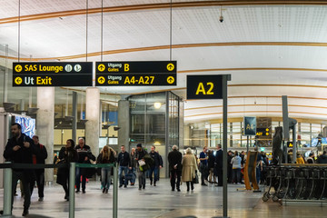 Oslo / Norway - November 30 2019: people at Gardermoen airport terminal for departure flight to travel aboard