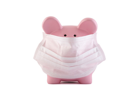 Pink piggy bank with protective medical mask isolated on white with clipping path. Banking during a pandemic concept.