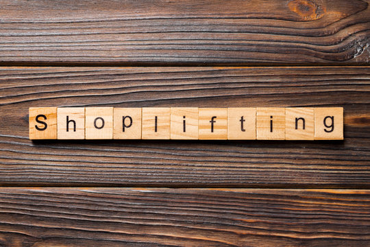 Shoplifting word written on wood block. Shoplifting text on wooden table for your desing, Top view concept