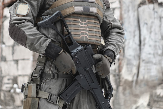 A military man with a machine gun is on duty.