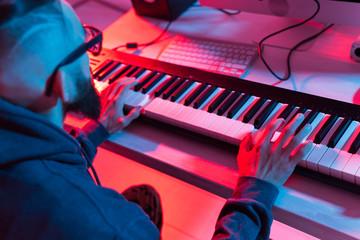 Fototapeta Male sound producer working in recording studio. obraz
