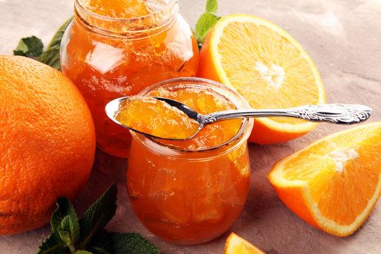 orange homemade jam marmelade in a glass jar. orange marmelade