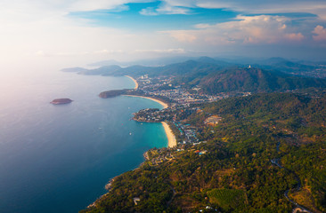 Wall Mural - Aerial view of the coastline of Phuket island with tropical sandy beaches and mountains at sunset, Thailand