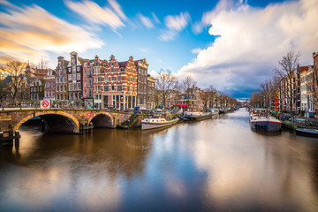 Amsterdam, Netherlands famous canals and bridges at dusk.