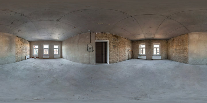 Empty room without repair. full seamless spherical hdri panorama 360 degrees in interior of gray loft room office with panoramic windows in equirectangular projection
