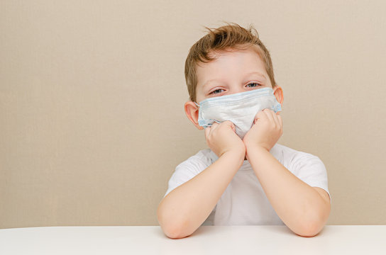 Cute boy of four years in a medical mask
