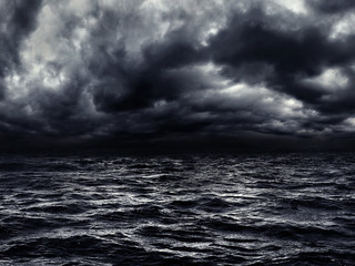 Fototapeten Dunkelgrau dark stormy sea with a dramatic cloudy sky