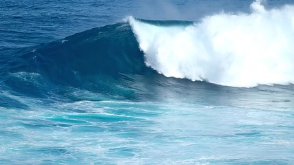 Wall Mural - Huge ocean wave breaks at the famous Jaws (Peahi) surf spot in Maui, Hawaii