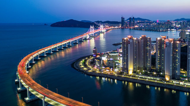Aerial view Busan Gwangan Daegyo Bridge or Gwangan Bridge skyline and skyscraper building architecture illuminated in the night. Busan, South Korea..