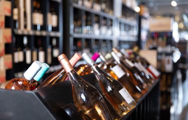 Poster de jardin Bar Rack with sparkling wine bottles in wine store