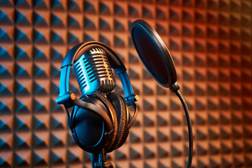 Retro microphone and pop filter on acoustic foam panel background