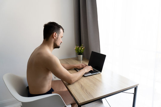 Man in pants should work from home during quarantine time because of coronavirus epidemia. He is freelancer. White background