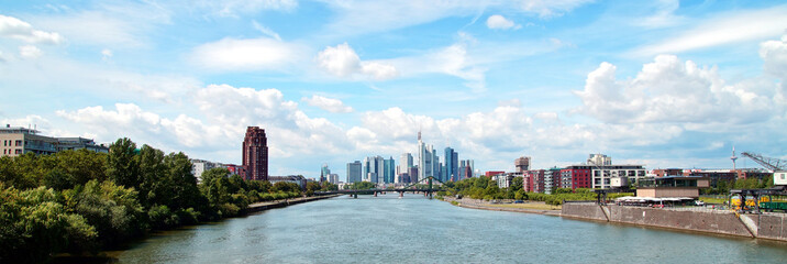 Poster Lichtblauw Skyline of Frankfurt, panoramic view of the river Main with the european city skyline, financial centre in germany. Skyscraper buildings on blue sky background. Business and finance concept