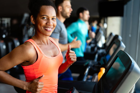 Happy woman smiling and working out in gym