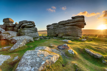 Wall Mural - Beautiful sunset over granite rock formations at Combestone Tor