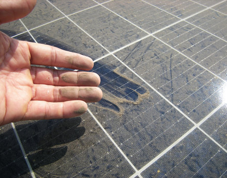 Dirty Hand after Rubbing Dusty Solar Panel