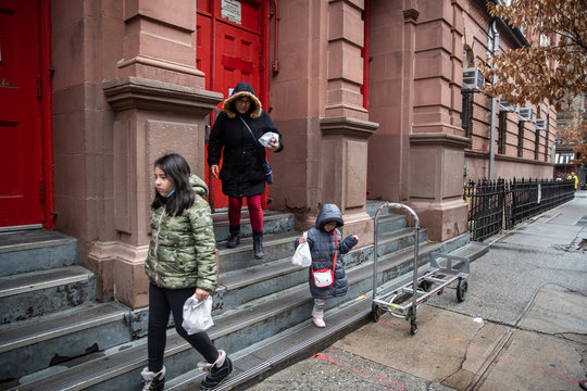 Children exit P.S. 042 Benjamin Altman school with school provided take out lunches in New York