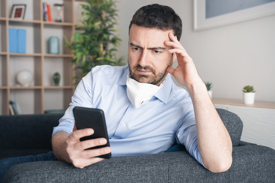 Worried man at home reading bad news about coronavirus contagion