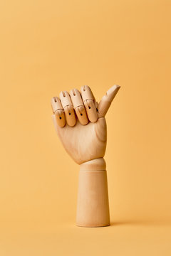 Wooden human hand with thumb raised up