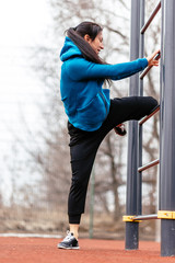 A young woman is engaged in sports on the Playground.